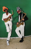 Funky musicians with saxophones — Stock Photo