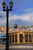 CIENFUEGOS, CUBA - 26 OCT, 2008. Street with Che Guevara's communist propaganda. — Stock Photo