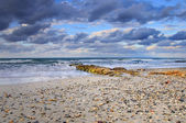 Tropical beach scene with colorful clouds — Stok fotoğraf