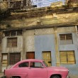 Old havana facade and vintage car — Stock Photo #48486605