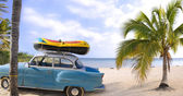 Old car in tropical beach — Stock Photo