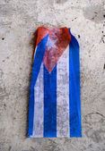 Cuban flag over eroded surface — Stock Photo