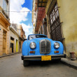 Old car in colorful Havana street — Stock Photo #48504455