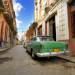 Old car in shabby Havana street, cuba — Stock Photo #48504555