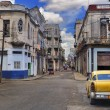 Panorama with old car in Havana street — Stock Photo #48509923