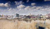 Eroded wall and havana skyline — Stock Photo