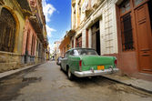 Old car in shabby Havana street, cuba — Stock Photo