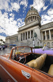 Vintage car in front of Capitol building in Havana. DEC 2009.  — Stock Photo