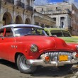 Havana street with colorful old cars in a raw — Stock Photo #48544241