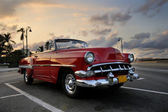 Red car in Havana sunset — Stok fotoğraf