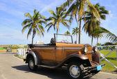 Vintage tropical car — Stock Photo