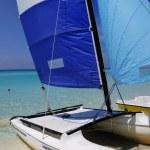 Cuban beach and saling boat — Stock Photo #48580075