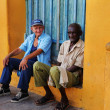 ������, ������: Two senior men in Trinidad street cuba OCT 2008