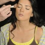 Hands applying make up on hispanic girl — Stock Photo #49168715