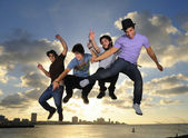 Young male team jumping outdoors — Foto de Stock