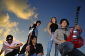 Group of young musicians posing with instruments — Stock Photo