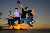 Happy young male group jumping of joy — Stock Photo
