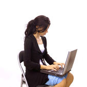 Isolated girl typing on laptop — Stock Photo