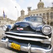 Old car parked in front of the Revolution museum in Havana, Cuba — Stock Photo #49432889
