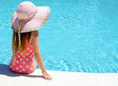 Young girl sat by the pool  — Stock Photo