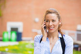 Business woman on a phone, outdoors — Stock Photo