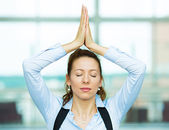 Meditating business woman — Stock Photo