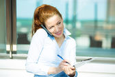 Busy business woman on a phone — Stock Photo