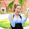 Excited woman giving thumbs up — Stock Photo