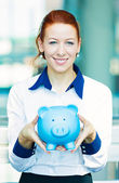 Business woman holding piggy bank — Stock Photo
