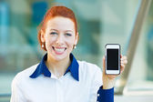Happy, smiling woman showing her smart phone — Stock Photo