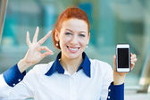 Happy woman showing her smart phone giving ok sign — Stock Photo