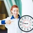 Business woman pointing on wall clock — Stock Photo #48158377