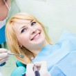 Happy female patient in dentist office — Stock Photo #48219449