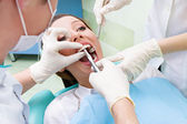 Female patient in dentist office getting tooth  procedure  — Stock Photo