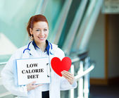 Doctor holding low calorie sign — Stock Photo