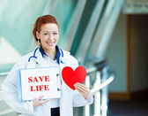 Doctor holding save life sign — Stock Photo