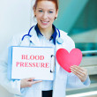 Female doctor holding red heart — Stock Photo #48394113
