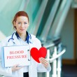 Female doctor holding red heart — Stock Photo #48394121