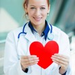 Female doctor holding red heart — Stock Photo #48394127