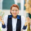 Confused woman holding credit cards and cash — Stock Photo #48435493