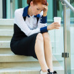 Stressed businesswoman with headache — Stock Photo