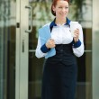 Businesswoman leaving her corporate office — Stock Photo #48435639