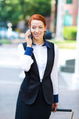Businessman outdoors,  speaking on phone — Stock Photo