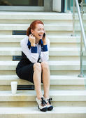 Woman talking on phone outside her corporate office — Stockfoto