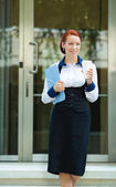 Businesswoman leaving her corporate office — Stock Photo