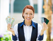 Bank agent showing convinience of electronic money — Stock Photo