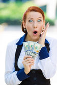 Excited woman holding dollar bills — Stockfoto
