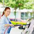 Young woman washing her car — Stock Photo #48568141
