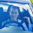 Woman pulling on seatbelt inside black car — Stock Photo #48568269