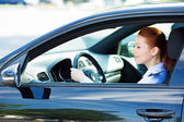 Woman driving car, follows traffic rules, precautions  — Foto Stock